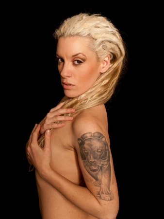 Beautiful Urban Girl with blond dreadlocks. Black panther tattoo photo