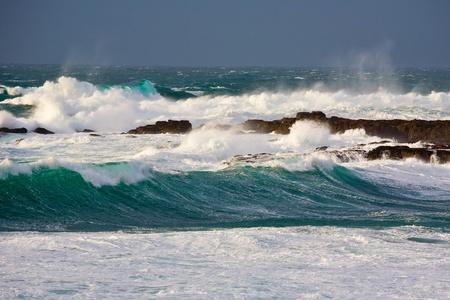 sennen: Storm waves crashing at Sennen Cove Cornwall England UK Stock Photo