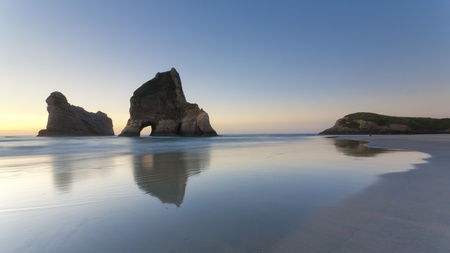 zealand: Rippled Sand and rock formations at Wharariki Beach, Nelson, North Island, New Zealand