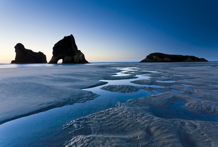 rock formations: Rippled Sand and rock formations at Wharariki Beach, Nelson, North Island, New Zealand