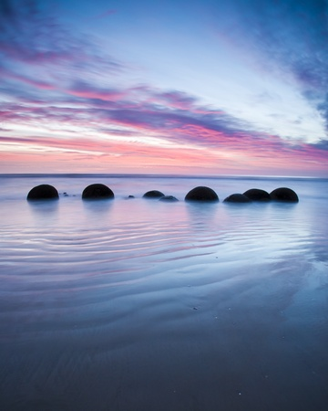 unusually: Moeraki Boulders at Sunrise South Island New Zealand Stock Photo
