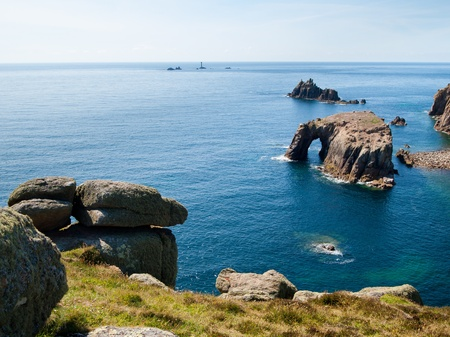 Rock formations off the coast at Lands End Cornwall England UK Stock Photo - 13212393