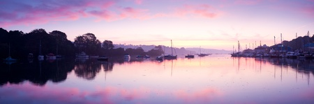 Stunning panorama of a peaceful River at Sunrise. Penryn Cornwall England UK photo