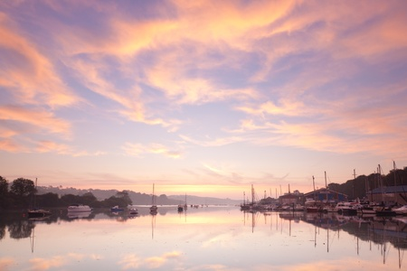 Beautiful dawn sky over the tidal River at Penryn Cornwall England UK photo