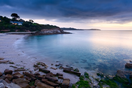 Moody sunrise at Swanpool Falmouth Cornwall England UK Stock Photo - 13211988