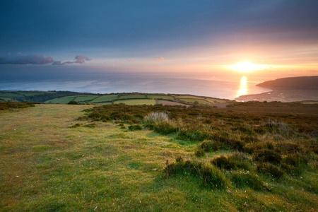Sunrise over Porlock from Porlock Hill, Somerset, England UK photo