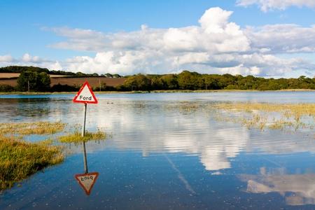 st john: Flooded River Fording point at St John Cornwall England UK