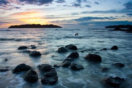 catalina: The sun setting behind Isla Santa Catalina photographed from Santa Catalina Panama