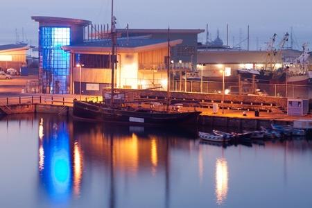 The fish market building at Brixham Harbour Devon England UK photo