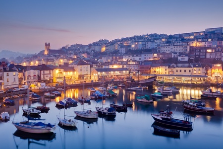 Overlooking Brixham harbour at dusk, Devon England UK