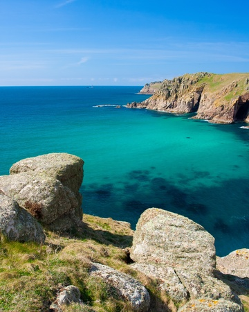Stunning turquoise blue sea at Pendower Cove on the Cornwall Coast Path  Stock Photo