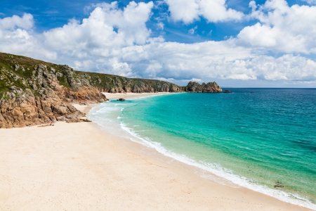 View along the golden sandy beach at Porthcurno Cornwall England UK