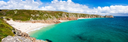 Panoramic view of Porthcurno Beach and Treen Cliffs from the coastpath near the Minack Cornwall England UK