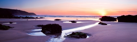 Panoramic shot of sunset on Porthtowan Beach, Cornwall photo