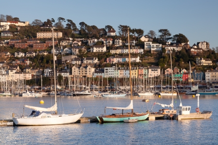 Row of boats moored on the River Dart with Kingswear in the background. photo
