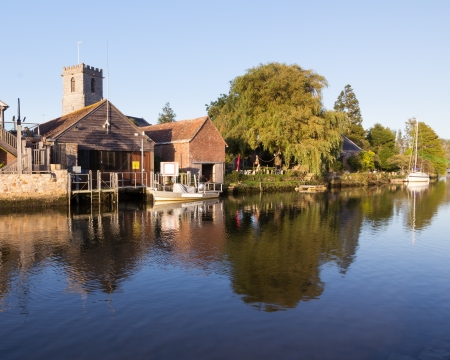 Wareham Quay Dorset England on the River Frome with the Old Granary and the Church of Lady St. Mary. Stock Photo