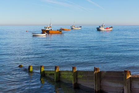Boats moored off Selsey Bill, West Sussex England UK