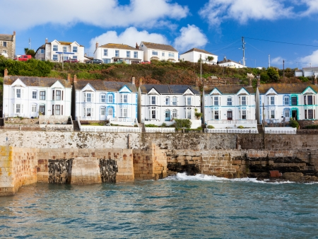 Row of seaside houses at Porthleven Cornwall England UK photo
