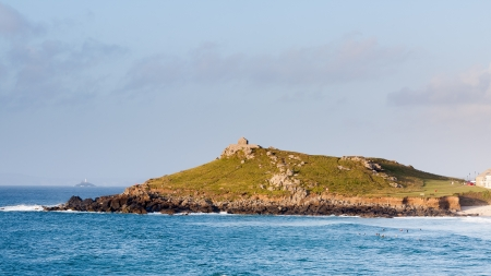 The Island at St Ives Cornwall England photographed from between Porthmeor Beach and  Clodgy Point  photo