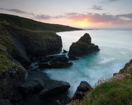 Sunset on the cliffs near Clodgy Point, St Ives Cornwall England UK  photo