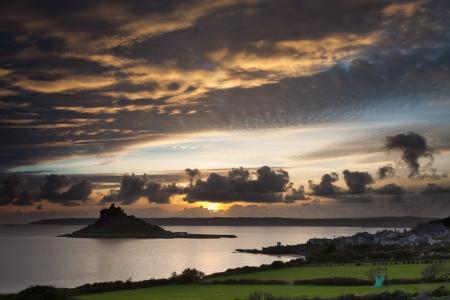 Sunset over St Michaels Mount and Marazion Cornwall England UK photo