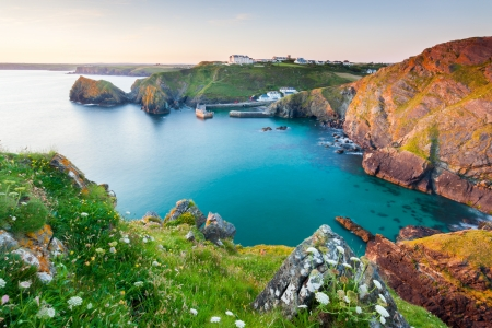 Sunset overlooking Mullion Cove Cornwall England UK