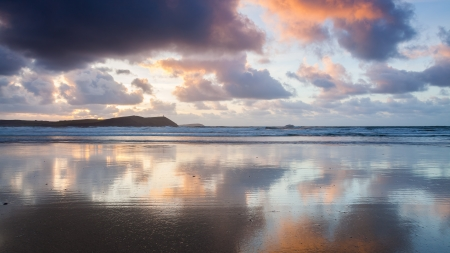 Dramatic reflections on the beach at New Polzeath Cornwall England UK photo
