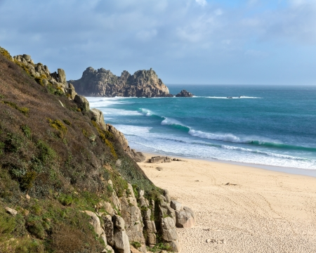 porthcurno: Overlooking the beautiful golden sandy beach at Porthcurno Cornwall England UK Stock Photo