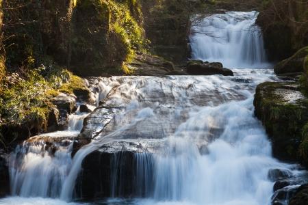 watersmeet: Watersmeet Falls, where the East Lyn River and Hoar Oak Water converge, Devon England UK