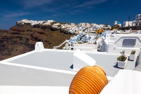 fira: Firostefani near Fira on Thira Island Santorini Greece. In the distance is Imerovigli. Stock Photo