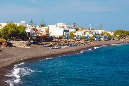 The black volcanic beach at Kamari Santorini Greece Stock Photo