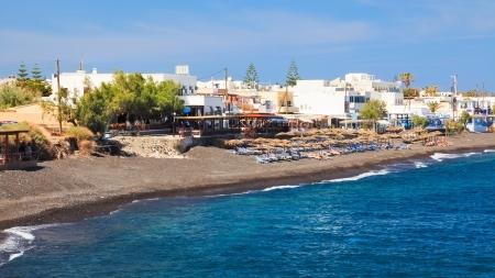 The black volcanic beach at Kamari Santorini Greece photo