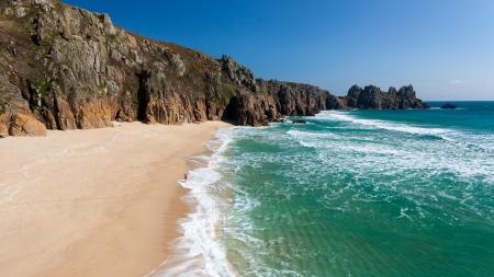 Pedn Vounder Beach with Treryn Dinas headland also called Logans Rock, Cornwall England UK