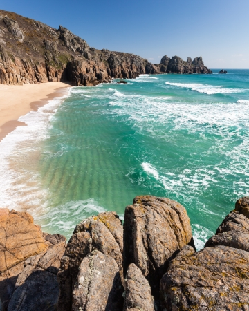 porthcurno: Pedn Vounder Beach with Treryn Dinas headland also called Logans Rock, Cornwall England UK