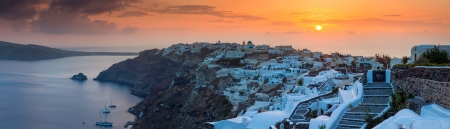 cycladic: Panorma of the sun settings over Oia on the Island of Santorini Greece.