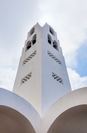 Bell tower of Fira Orthodox Cathedral, Santorini Greece photo