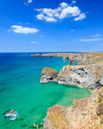 Summer view along Carnewas Cliffs Cornwall England with Bedruthan Steps in the background. photo