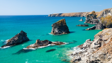 Summers day and turquoise sea at Bedruthan Steps Cornwall England UK photo