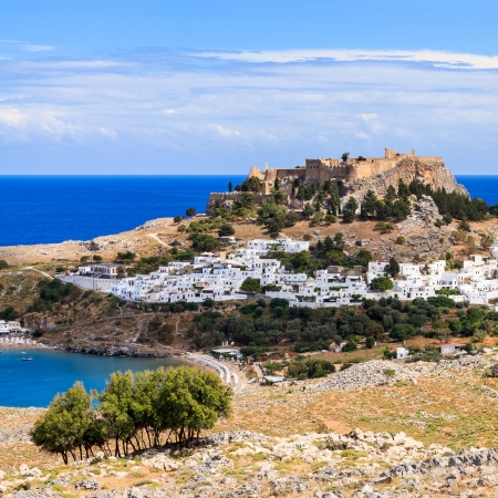 View from the road down to the popular town of Lindos on the Island of Rhodes Greece Europe