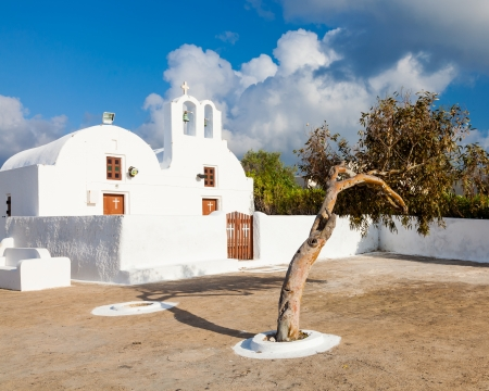 Tiny greek church at Oia Santorini Greece Europe photo