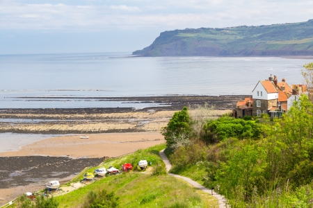 Beach and sea front at Robin Hoods Bay Yorkshire England UK Europe photo