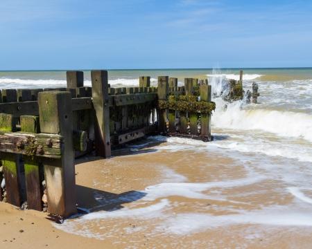 groynes: Timber Groynes at Mundesley on the Norfolk Coast England UK Europe