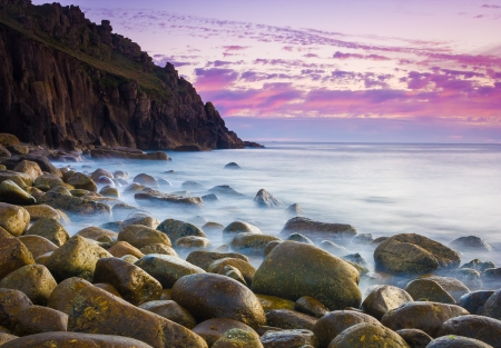 loe: Beautiful dusk at the remote Porth Loe Cove Cornwall England UK