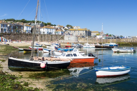 mousehole: Summer at the historic fishing harbour Mousehole Cornwall England UK Europe Stock Photo