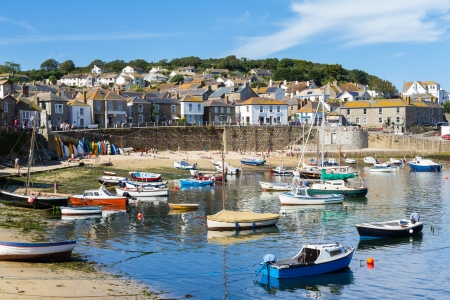 Summer at the historic fishing harbour Mousehole Cornwall England UK Europe Stock Photo