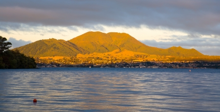 Evening light on Mountains Behind Taupo viewed from Acacia Bay, North Island, New Zealand photo