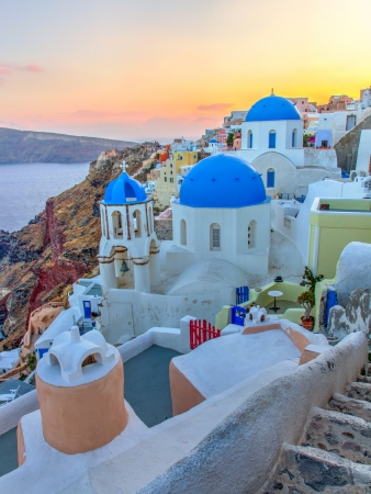 Sunset view of blue dome churches on Santorini Island  Greece Europe