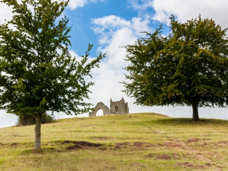 burrow: Burrow Mump is a hill and historic site overlooking Southlake Moor in Burrowbridge Taunton  Somerset, England.