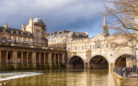 Completed in 1774 designed by Robert Adam in a Palladian style, Pulteney Bridge crosses the River Avon in Bath, England UK Europe