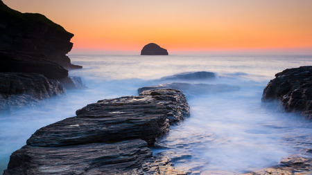 Susnet and rocks at Trebarwith Strand on the North Cornwall Coast England UK Europe photo